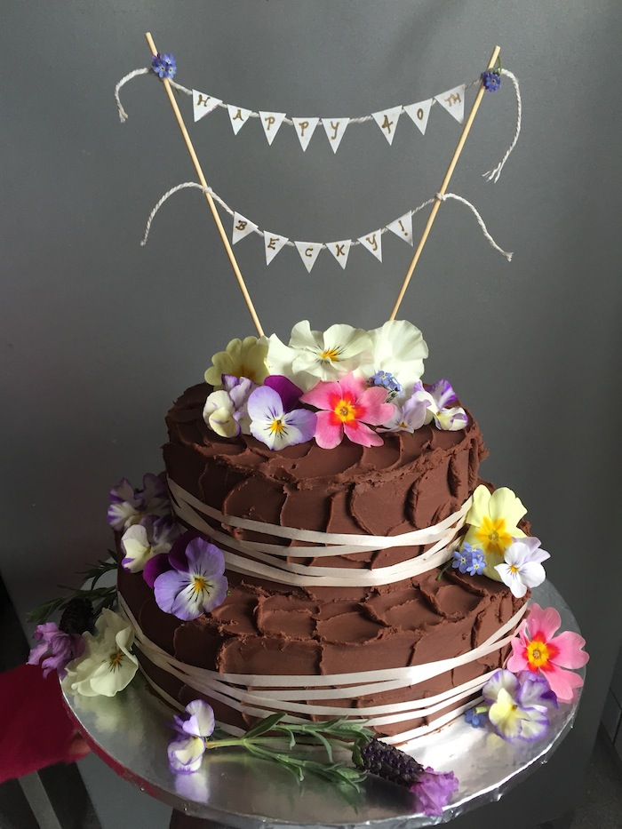 Chocolate birthday cake with edible flowers
